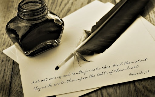 bible, quill and ink